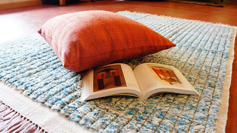 Twill-woven raw silk pillow on shaggy rug