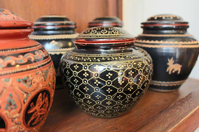 Selection of round lacquerware storage jars