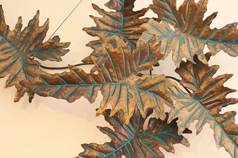 Wall decoration of large metal leaves