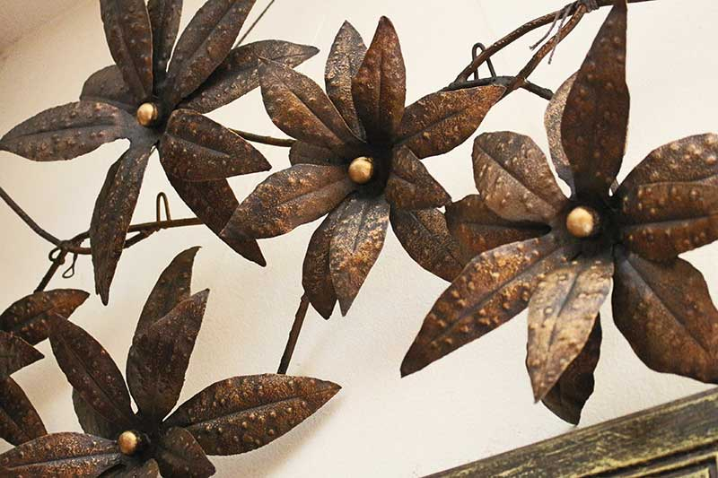 Detail of large metallic floral wall decoration from Chiang Mai