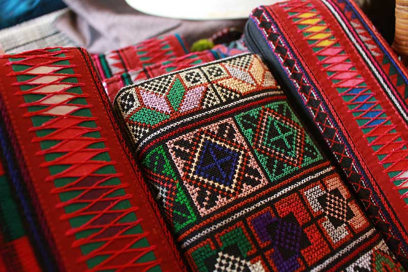 Tribal applique and needlework purses