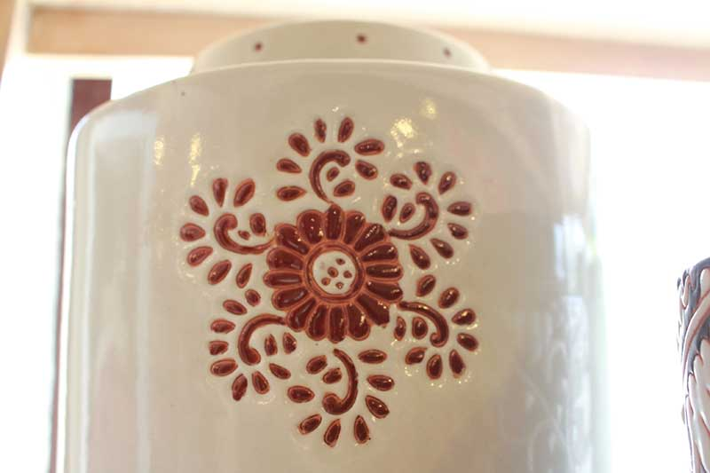 Detail on ceramic tea leaf storage container