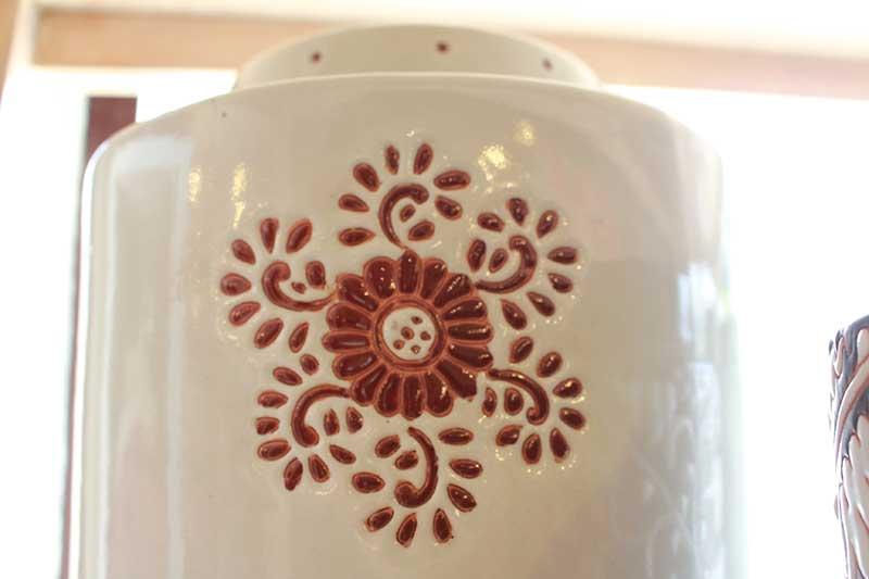 Detail on ceramic tea leaf storage container