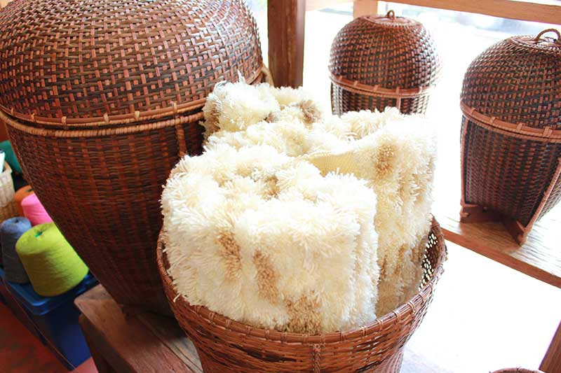 Rolled shaggy rugs and Karen baskets