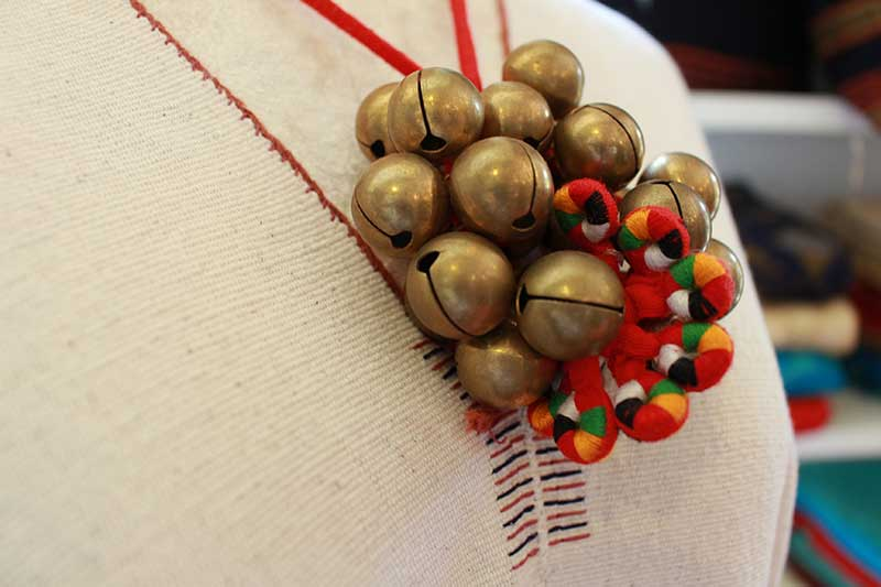 Necklace with pendant of Myanmar brass bells and tribal needle work