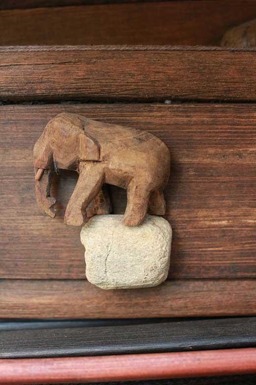 Elephant decoration on teak wood fabric display hanger, Chiang Mai