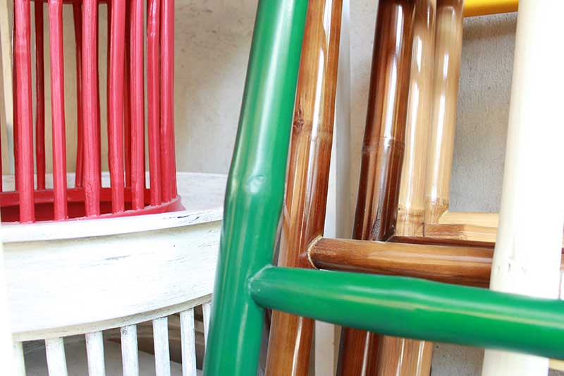 Close-up of colorfully painted bamboo towel racks and traditional northern Thai Kantok dining table