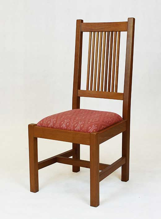 Classic American Mission teak dining chair with ikat cotton seat