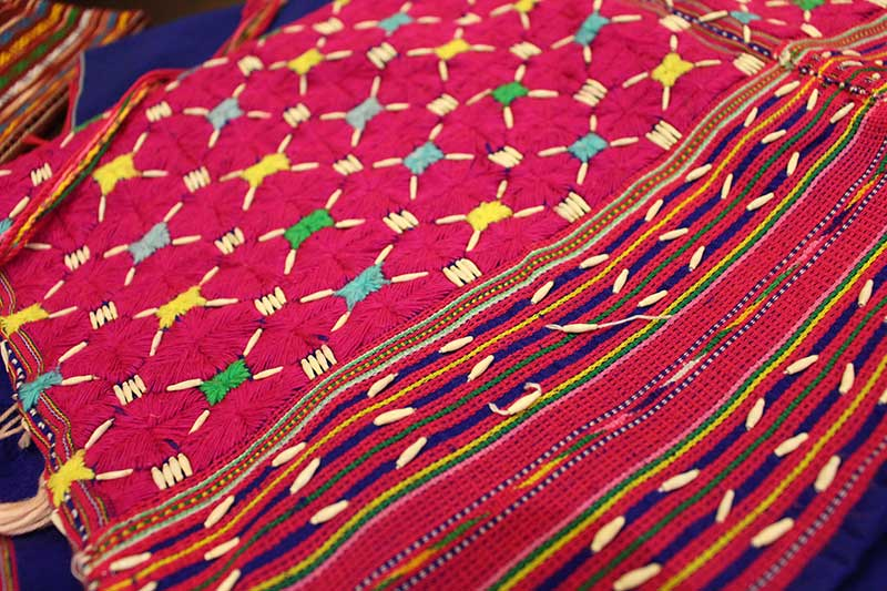 Karen poncho embroidered with wild grass seeds