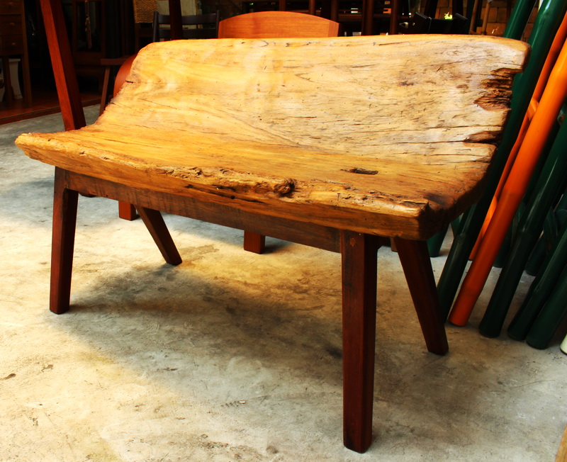 Teak bench made from a section of a traditional rice mortar
